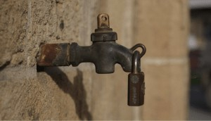 a faucet with a padlock attached