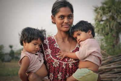 Indian woman holding two children