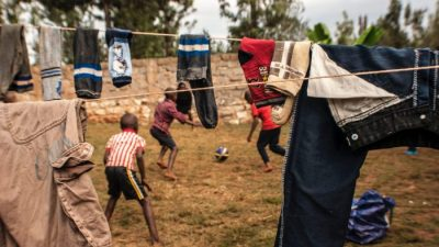 Kids playing soccer in Kenya