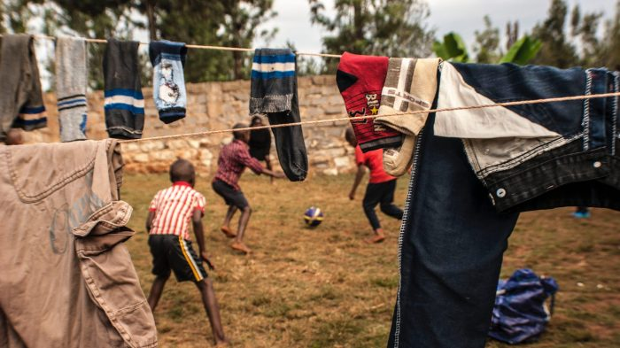 Kids playing soccer in Kenya