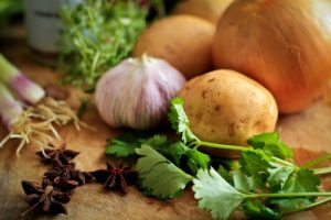 close up of onions, potatoes, cilantro